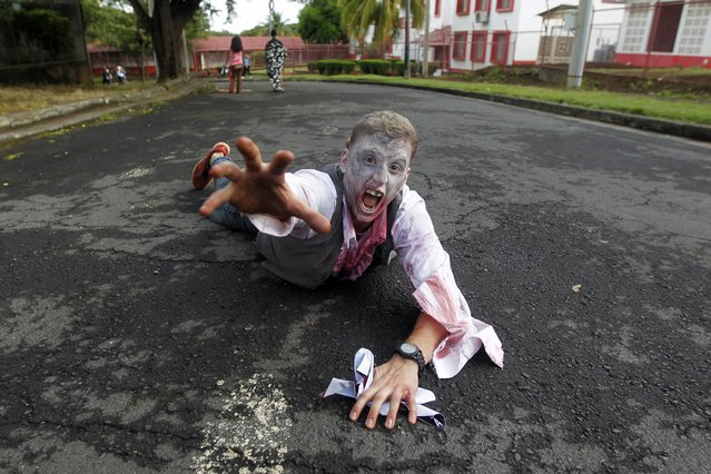A man dressed as zombie takes part in a zombie race to raise funds for children with cancer at the child Hospital Manuel de Jesus Rivera in Managua October 19, 2014. (Photo by Oswaldo Rivas/Reuters)
