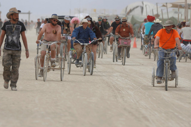 Participants travel through Black Rock City as approximately 70,000 people from all over the world gather for the 30th annual Burning Man arts and music festival in the Black Rock Desert of Nevada, U.S. September 3, 2016. (Photo by Jim Urquhart/Reuters)