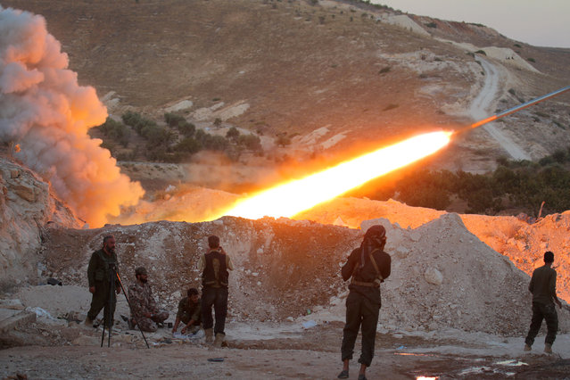 Free Syrian Army fighters launch a Grad rocket from Halfaya town in Hama province, towards forces loyal to Syria's President Bashar al-Assad stationed in Zein al-Abidin mountain, Syria September 4, 2016. (Photo by Ammar Abdullah/Reuters)