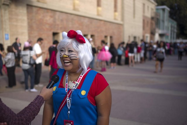 Carolyn Molina, of Riverside, Calif., laughs while talking to a reporter at the Hello Kitty Con, the first-ever Hello Kitty fan convention, held at the Geffen Contemporary at MOCA Thursday, October 30, 2014, in Los Angeles. (Photo by Jae C. Hong/AP Photo)