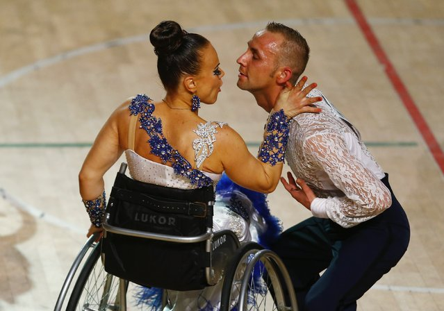 Hanna Stasiuk and Ihar Kuliashou of Belarus dance as they compete during IPC Wheelchair Dance Sport European Championships in Lomianki near Warsaw, November 9, 2014. (Photo by Kacper Pempel/Reuters)