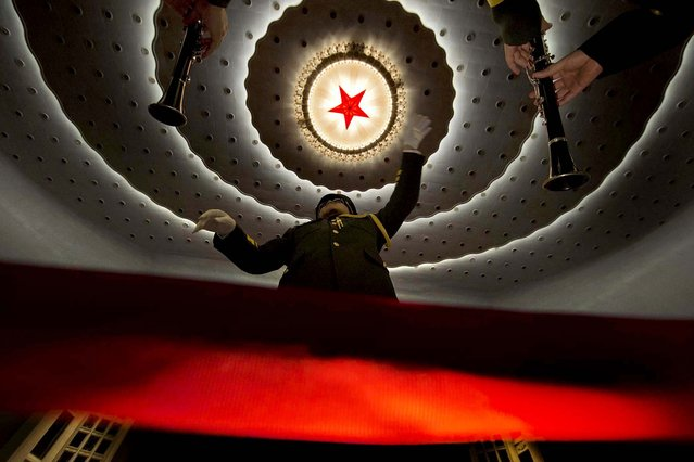 A military band conductor rehearses before the opening session of the Chinese People's Political Consultative Conference in Beijing's Great Hall of the People March 3, 2013. (Photo by Ng Han Guan/Associated Press)