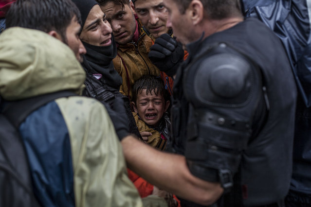 A Syrian refugee boy cries while he and his family try to board a train at the station in Tovarnik, Croatia, Sunday, September 20, 2015. (Photo by Manu Brabo/AP Photo)