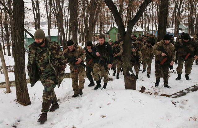 """Pro-Russian separatists from the Chechen """"Death"""" battalion walk during a training exercise in the territory controlled by the self-proclaimed Donetsk People's Republic, eastern Ukraine, December 8, 2014. (Photo by Maxim Shemetov/Reuters)"""