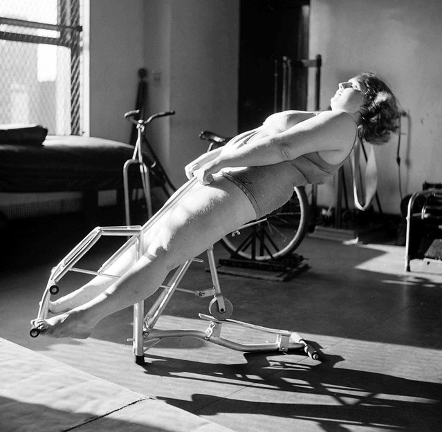 Dorothy Bradley, photographed for LIFE magazine article on obesity, works out in 1949. (Photo by Martha Holmes/Time & Life Pictures)