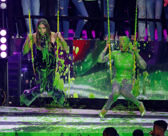 Heidi Klum (L) and Mel B. swing on swings on stage at the 31 st Annual Nickelodeon Kids' Choice Awards on March 24, 2018 at the Forum in Inglewood, California. (Photo by Mario Anzuoni/Reuters)