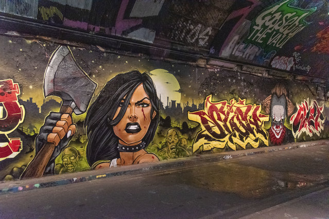 Graffiti of a woman with an axe part of the Halloween Paint Jam seen at the famous Leake Street Tunnel under Waterloo station on November 3, 2020. (Photo by Dave Rushen/SOPA Images/Sipa USA)