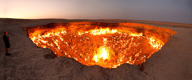 """Door to Hell"", a burning natural gas field in Derweze, Turkmenistan. (Photo by Tormod Sandtorv)"