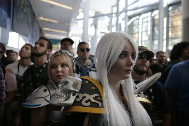 "Attendees wait for the start of the opening ceremony at BlizzCon, Friday, November 6, 2015, in Anaheim, Calif. ""World of Warcraft"" maker Blizzard is hosting its ninth annual fan-centric convention opening Friday. (Photo by Jae C. Hong/AP Photo)"