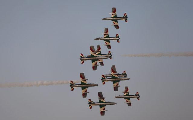 "The ""Frecce Tri Colori"" Italian Air Force aerobatic display team perform during the opening of the Dubai Airshow in Dubai, United Arab Emirates, Sunday, November 8, 2015. (Photo by Kamran Jebreili/AP Photo)"