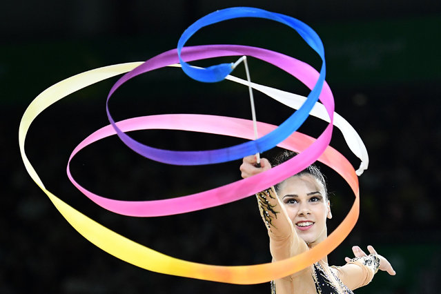 Cyprus' Diamanto Evripidou competes in the ribbon event of the rhythmic gymnastics individual all- around final during the 2018 Gold Coast Commonwealth Games at the Coomera Indoor Sports Centre on the Gold Coast on April 12, 2018. (Photo by Anthony Wallace/AFP Photo)