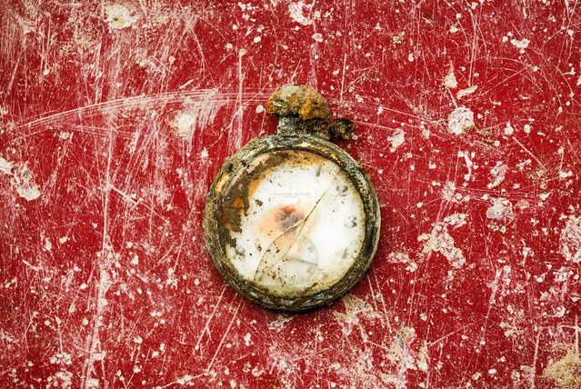 This photo taken on December 17, 2014, shows a pocket watch found during the exhumation of a mass grave of those killed by their political ideology during and after the Spanish civil war at the Puerto Real cemetery is displayed to be pictured by the photographer in Puerto Real, Spain. (Photo by Daniel Ochoa de Olza/AP Photo)