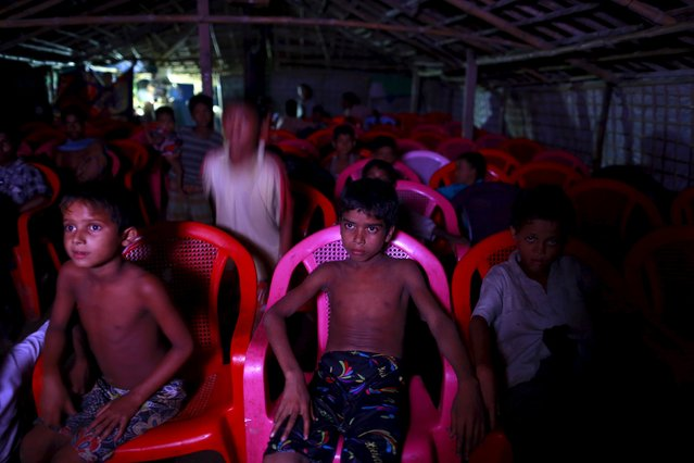 Muslim Rohingya children watch movies at a pay movie theater inside a refugee camp outside Sittwe  October 29, 2015. (Photo by Soe Zeya Tun/Reuters)