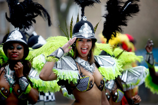 Performers take part in a rain soaked Notting Hill Carnival on August 25th, 2014 in London, England. Despite the bad weather over 1 million visitors are expected to attend the two-day event which is the largest of its kind in Europe. The event has taken place on the West London streets every August Bank Holiday weekend since 1964. (Photo by Mary Turner/Getty Images)
