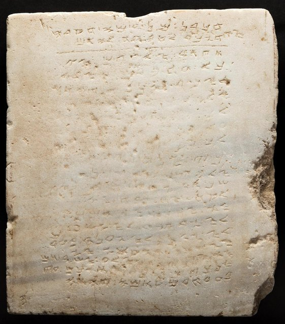A stone tablet thought to be about 1,500 years old with a, worn-down chiseled inscription of the Ten Commandments is seen in this photo released in Dallas, Texas, U.S., October 21, 2016. A stone tablet thought to be about 1,500 years old with a worn-down chiseled inscription of the Ten Commandments will be sold next month at auction, with a stipulation that the buyer must put it on public display, an auction house said on Friday. The two-foot (61 cm) square slab of white marble weighs about 200 pounds (90 kgs) and is believed to be the oldest existing stone inscription of the commandments, Dallas-Based Heritage Auctions said. Opening bid is $250,000 for the stone, which the current owner likes to point out is not the original. (Photo by Courtesy Heritage/Reuters)