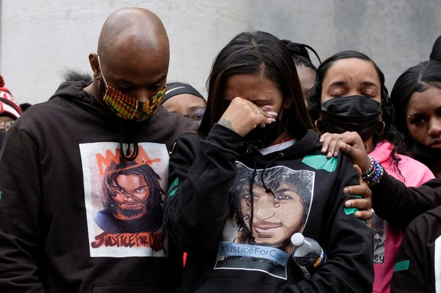 Sean Walton, the family attorney, comforts Tamala Payne, the mother of Casey Goodson Jr., a 23-year-old Black man who was killed by police last week as he entered his home, as people gathered to protest, outside of the State House in Columbus, Ohio, U.S., December 12, 2020. (Photo by Seth Herald/Reuters)
