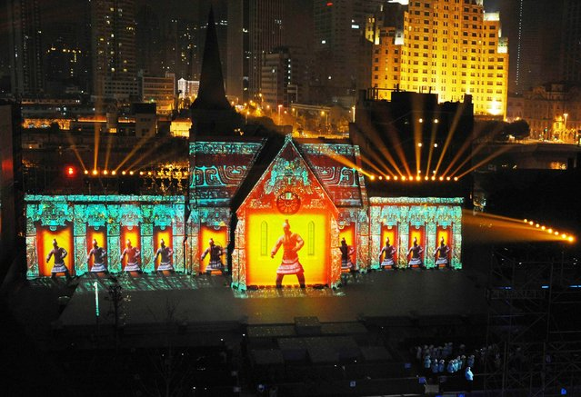 Images of Terra Cotta Warriors are projected on a building during a light show as part of a New Year countdown celebration rehearsal on The Bund in Shanghai, December 30, 2014. (Photo by Reuters/Stringer)