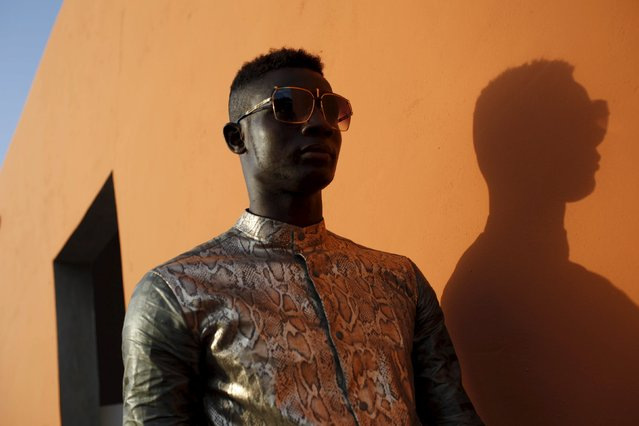 Model Mamadou Racine poses for a picture in a bazin suit made by designer Barros Coulibaly in Bamako, Mali, October 21, 2015. Gasps of delight filled the convention hall as models, decked out in Mali's signature bazin fabric in crimson reds, indigoes and neon greens, strutted the catwalk while musicians from across the West African nation provided the soundtrack. (Photo by Joe Penney/Reuters)