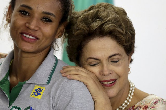 Brazil's President Dilma Rousseff reacts as she receives athletes from the national women's handball team, ahead of the Women's Handball World Championship in Denmark, at the Planalto Palace in Brasilia, Brazil November 25, 2015. (Photo by Ueslei Marcelino/Reuters)