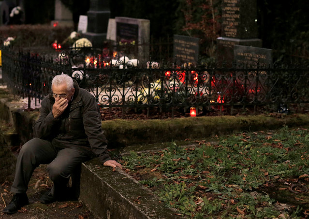 A man is seen nearby a grave during All Saints Day at Mirogoj cemetery in Zagreb, November 1, 2016. (Photo by Antonio Bronic/Reuters)