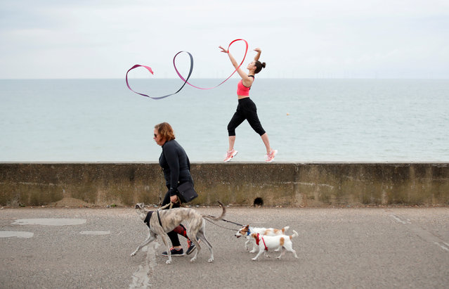 Team GB Rhythmic Gymnast Lynne Karina Hutchison during a training session on the seafront in Hove, following the outbreak of the coronavirus disease (COVID-19), Hove, Britain, June 10, 2020. (Photo by Peter Cziborra/Reuters)