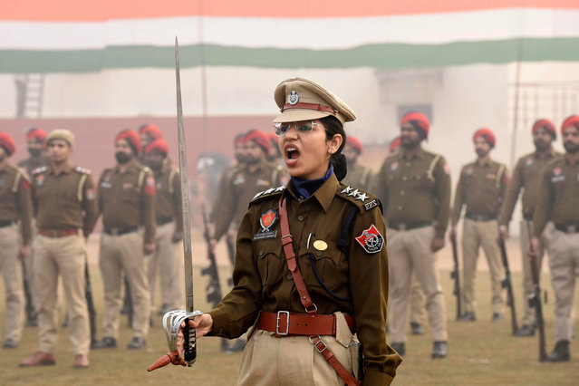 Police personnel take part in a rehearsal for the upcoming Republic Day parade, in Amritsar on January 21, 2021. (Photo by Narinder Nanu/AFP Photo)