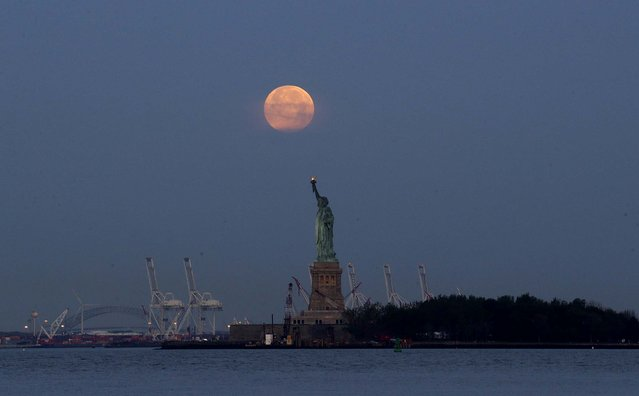 The Statue of Liberty in New York, on Sunday. (Photo by Julio Cortez/Associated Press)