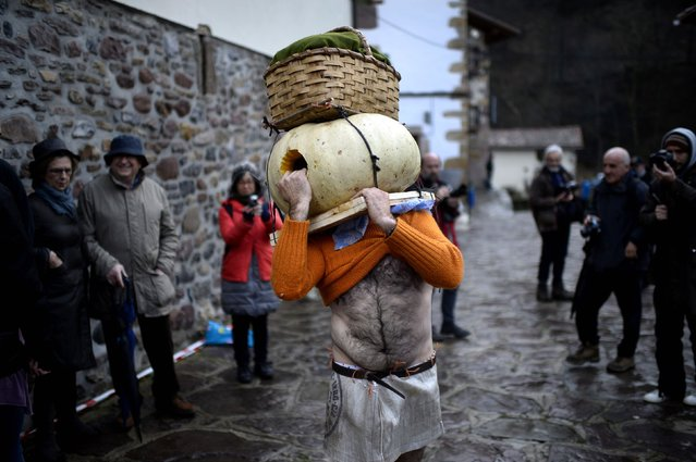 A man wears a pumpkin on his head during carnival celebrations in Zubieta January 27, 2015. (Photo by Vincent West/Reuters)