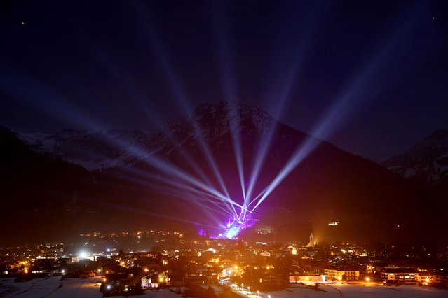 General view of a laser light show at the opening ceremony of the FIS Nordic World Ski Championships in Oberstdorf, Germany, February 24, 2021. (Photo by Kai Pfaffenbach/Reuters)