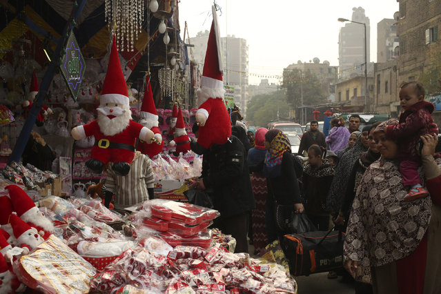 People look at Santa Claus themed Christmas items at a street market in Cairo, Egypt December 21, 2015. (Photo by Asmaa Waguih/Reuters)