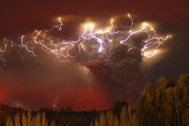 Lightning flashes around the ash plume above the Puyehue-Cordon Caulle volcano chain near Entrelagos, Chile, June 2011. (Photo by Carlos Gutierrez/Reuters)