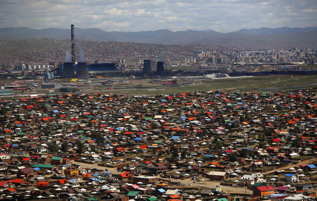 An area known as a ger district is seen in Ulan Bator June 28, 2013. Approximately 60 percent of the population of Ulan Bator live in settlements known as ger districts and in many cases residents have limited access to basic services such as water and sanitation. According to a 2010 National Population Center census, every year between thirty and forty thousand people migrate from the countryside to the capital Ulan Bator. Ger districts in the city have been expanding rapidly in recent years. Mongolia is the world's least densely populated country, with 2.8 million people spread across an area around three times the size of France. (Photo by Carlos Barria/Reuters)