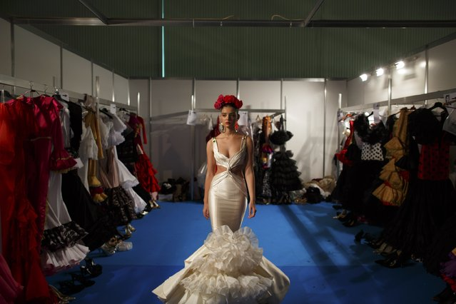 A model walks before presenting a creation by Rafael Leveque backstage during the International Flamenco Fashion Show SIMOF in the Andalusian capital of Seville February 5, 2015. (Photo by Marcelo del Pozo/Reuters)