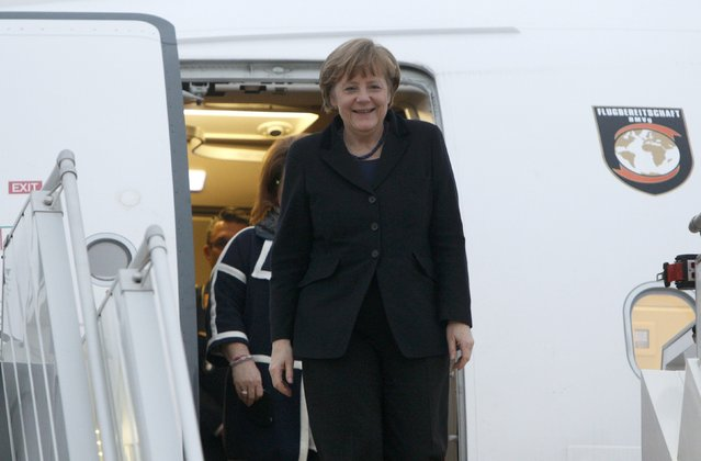 Germany's Chancellor Angela Merkel walks down the stairs upon her arrival at an airport near Minsk, February 11, 2015. (Photo by Valentyn Ogirenko/Reuters)