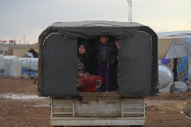 Internally displaced Syrians ride a vehicle inside a refugee camp in the Hama countryside, Syria January 1, 2016. (Photo by Ammar Abdullah/Reuters)