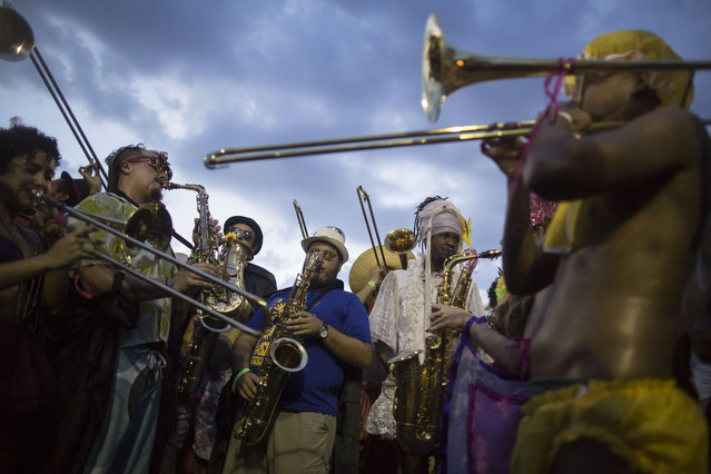 "Revelers perform during the ""Bloco Virtual"" carnival parade at Leme Beach in Rio de Janeiro, Brazil, Friday, February 13, 2015. (Photo by Felipe Dana/AP Photo)"