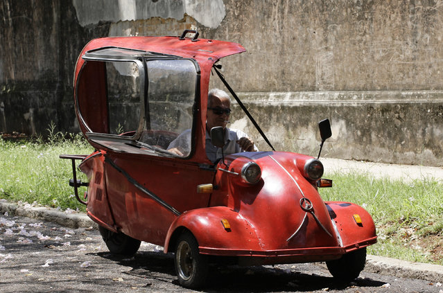 Jose Alberto Sarmiento sits in his 1957 Messerschmitt KR200 microcar on a street in Havana May 20, 2010. The bubble car has been in the possession of the lamp maker's family since before the Cuban Revolution. The three-wheeler was produced by the German aircraft manufacturer Messerschmitt from 1955 to 1964. There are only 36 of the cars remaining in Cuba. (Photo by Desmond Boylan/Reuters)