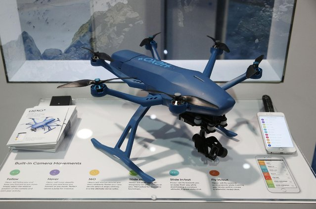 The Hexo+ Your Self-Flying Camera drone is on display at the Hexo+ booth during CES International, Thursday, January 7, 2016, in Las Vegas. The fully autonomous drone has no controller. Using a smart phone app, the user selects how and from what angle you want the drone to take video of you and it will automatically follow you around with it's camera. (Photo by John Locher/AP Photo)