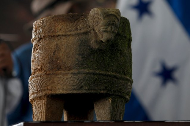 "An archaeological piece is displayed during an official ceremony at El Aguacate air base in Catacamas, Honduras, January 12, 2016. Archaeologists on Tuesday begin the excavation of a mythical city hidden in the eastern Mosquitia region of Honduras, where drug cartels operate, amid strict military vigilance. The ruins of an unknown culture were discovered in 2012, fueling the legend of the ""White City"" allegedly built by a pre-Columbian civilization. (Photo by Jorge Cabrera/Reuters)"