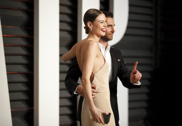Musician Adam Levine and wife, model Behati Prinsloo, arrive at the 2015 Vanity Fair Oscar Party in Beverly Hills, California February 22, 2015. (Photo by Danny Moloshok/Reuters)