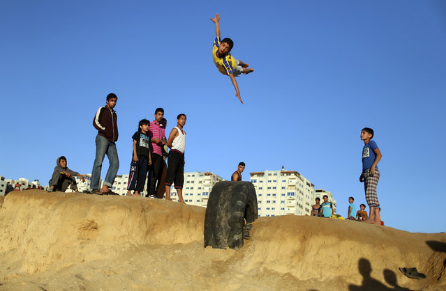 A Palestinian youth practices his parkour skills at the Shati refugee camp in Gaza City, April 27, 2014. (Photo by Mohammed Salem/Reuters)