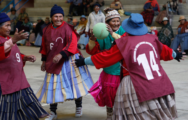 In this February 11, 2105 photo, 72-year-old Aurea Murillo prepares to make a pass during a handball match among elderly Aymara indigenous women in El Alto, Bolivia. Dozens of traditional Aymara grandmothers ease many of the aches and pains of aging by practicing a sport that is decidedly untraditional in Bolivia: team handball. (Photo by Juan Karita/AP Photo)