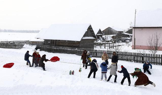 Villagers play as they take part in Kolyada holiday celebrations in the village of Martsiyanauka, Belarus, January 21, 2016. (Photo by Vasily Fedosenko/Reuters)