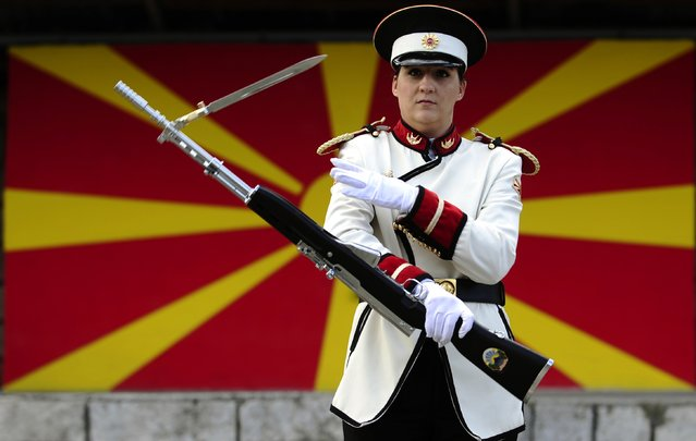 Corporal Verica Zlatevska attends an honour guard training session at an army barracks in Skopje March 4, 2015. Macedonia's honour army battalion, the ceremonial uniformed guard that receives every foreign president, dignitaries and delegations, but also sees off and welcomes the head of state every time he leaves the country, has a different glow. For the first time in the history of Macedonia's army, the honour guard has two women in its ranks. There has not been an event in which one of them is not in the first row. Zlatevska joined the army in 2003, Dragana Kitanovska in 2006. Picture taken March 4, 2015.   REUTERS/Ognen Teofilovski (MACEDONIA - Tags: MILITARY SOCIETY)