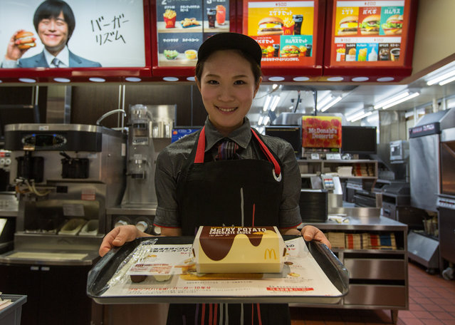 McDonald's Japan Swing Manager Miwa Suzuki presents a box of McChoco Potato on January 25, 2016 in Tokyo, Japan. The McChoco Potato, McDonald's Japan's special winter menu, french fries covered in chocolate and white chocolate sauces will be available in McDonald's restaurants on January 26, 2016 until around mid February. (Photo by Christopher Jue/Getty Images)