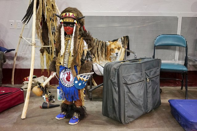 Wechpa Rowland, dressed in a buffalo costume, waits for the Grand Entry at the Denver March Powwow in Denver March 20, 2015. The annual event attracts almost 100 Native American tribes with over 1,000 Indian dancers. (Photo by Rick Wilking/Reuters)