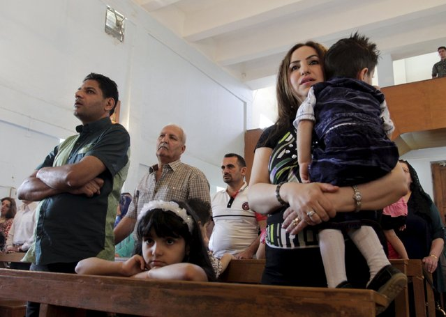 Iraqi Christians attend an Easter mass at the Virgin Mary church in Basra, southeast of Baghdad April 5, 2015. (Photo by Essam Al-Sudani/Reuters)