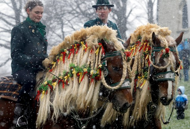 "Pilgrims dressed in traditional Bavarian clothes attend the traditional Georgi horse riding procession on Easter Monday in heavy snowfall, in the southern Bavarian town of Traunstein April 6, 2015. Since the early 16th century, farmers have taken part in the pilgrimage to bless their horses. This tradition, the ""Georgiritt"", goes back to the legend of Saint George, the horsemen's patron saint. (Photo by Michael Dalder/Reuters)"