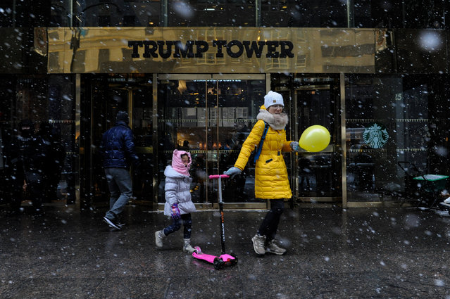 A woman and child exit Trump Tower during a snow storm in New York City, U.S. January 7, 2017. (Photo by Stephanie Keith/Reuters)