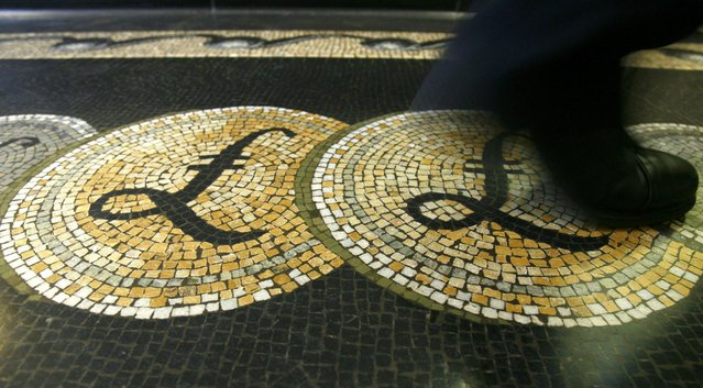 An employee is seen walking over a mosaic of pound sterling symbols set in the floor of the front hall of the Bank of England in London, in this March 25, 2008 file photograph. Sterling had its biggest one-day loss against the dollar in 11 months on February 22, 2016 after London Mayor Boris Johnson threw his weight behind the campaign to leave the European Union, dealing a blow to David Cameron by increasing the chance of a British exit from the EU. (Photo by Luke MacGregor/Reuters)